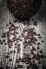 Sphere of coffee and coffee beans on old gray wooden table. Tone