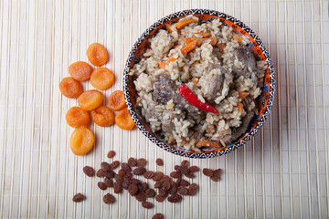 Pilaf  in Turkish bowl with dried apricots and raisins