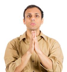 Sad man praying