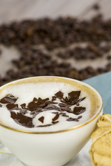 Cup of freshly brewed aromatic cappuccino coffee