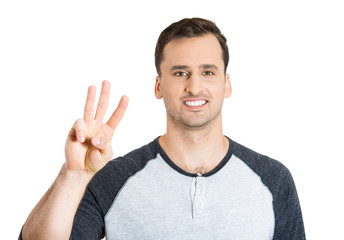 man giving a three fingers sign gesture with hand