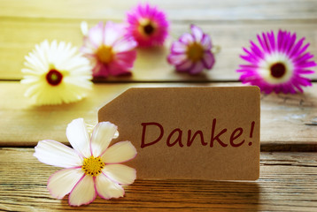 Sunny Label With German Text Danke With Cosmea Blossoms