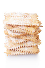 Chiacchiere, italian pastry stack on white, clipping path