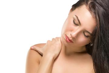 Brunette woman massaging her shoulder