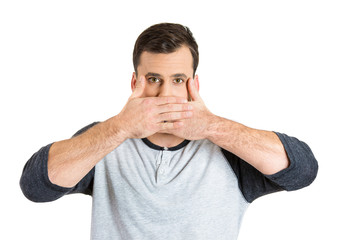 Headshot young man covering his mouth with hands