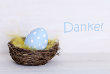 One Blue Easter Egg In Nest With German Danke Means Thank You