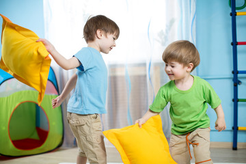 kids boys  playing with pillows
