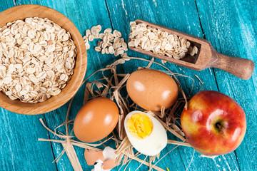 Organic eggs on blue wood background
