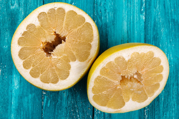 Pomelo fruit on wooden surface