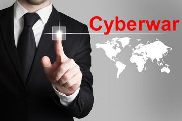 businessman pushing button cyberwar worldmap