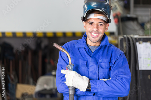 Leinwanddruck Bild Professional welder posing with wellding machine