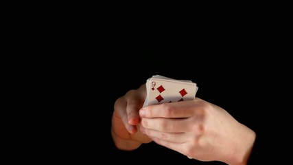 Magician shows playing card trick concept on black background