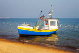 Fototapeta Fishing boat on the beach in Sopot, Poland.
