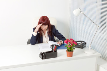 business woman sitting in office and working with documents
