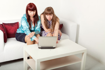 two girls works together on notebook