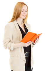 smiling businesswoman wearing jacket reads diary