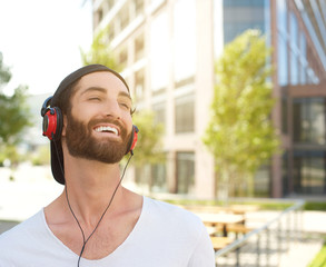 Young man laughing with headphones