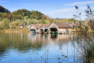 boathouses and reed at lake Kochelsee