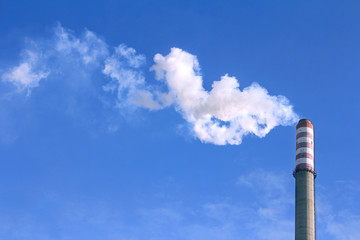 Smoke clouds from a high chimney