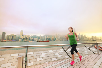 Asian chinese woman runner jogging in Hong Kong