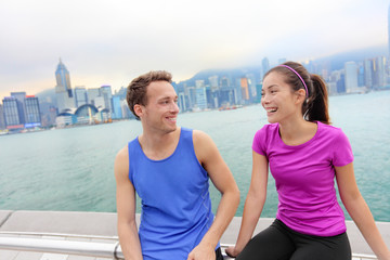 Runners relaxing after workout in Hong Kong city