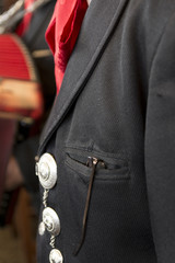 close up of traditional clothes of a mexican mariachi