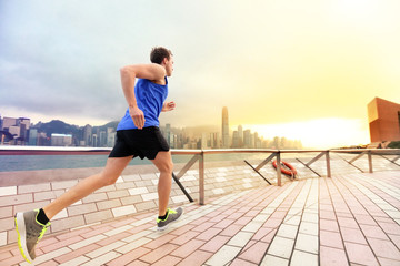Urban running man runner in Hong Kong city skyline