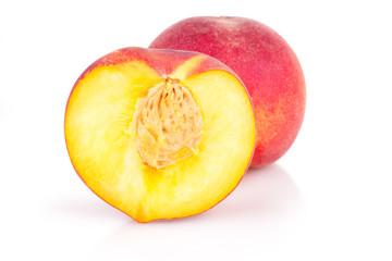 cut peaches on a white background