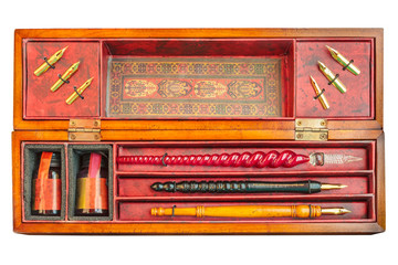 Antique fountain pen set in box isolated on white
