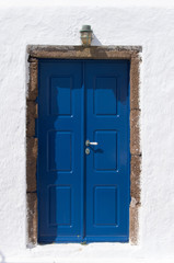 Blue wooden door on white background