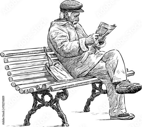 senior reading a newspaper - 78276889