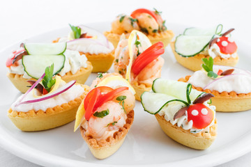 Assortment of mini tartlets, vegetable, shrimps, cream cheese