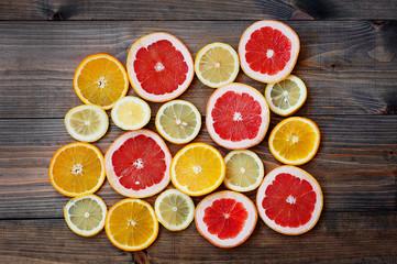 grapefruit lemon orange on a dark background