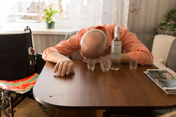 Drunk Disable Old Man Sleeping on the Table