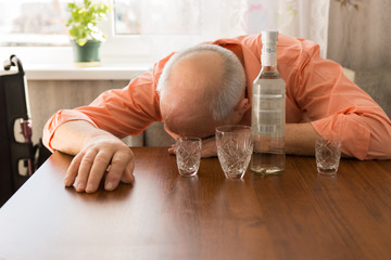 Drunk Bald Elderly Taking a Nap on the Table