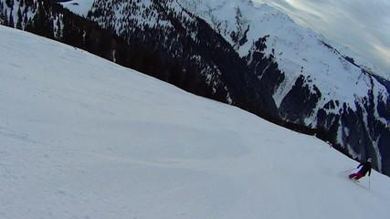 Skier on ski slope, slow motion, Alps, Austria, pov