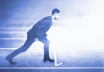 man standing on running track