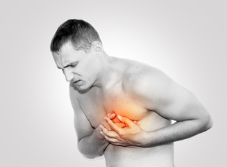 Young man having heart pain