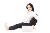Young office woman with laptop exercising on white background