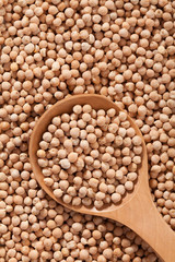 Chickpeas background with large spoone full with seed