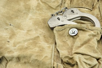 Handcuffs in The Camouflage Army Pants Pocket or Haversack