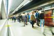 Leinwandbild Motiv London Train Tube underground station Blur people movement