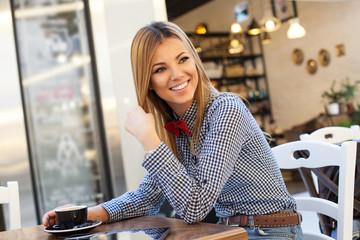 Modern woman sitting in coffee shop
