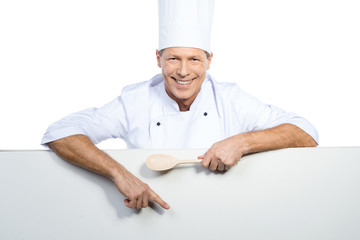 Chef pointing copy space.