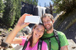 Couple hiking taking smartphone selfie in Yosemite