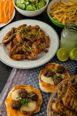 Sports feast - chicken wings, vegetable, french fries, pizza