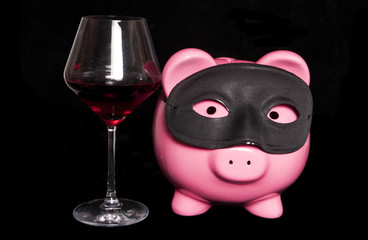 piggy bank masquerade with red wine