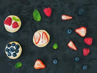 Berry and ricotta tarts, mint leaves, strawberries, raspberries,
