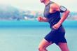Cardio runner running listening smartphone music