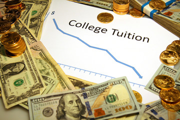 college tuition chart graph down falling with gold money